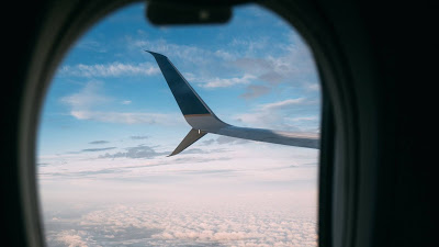 HD wallpaper porthole, plane, wing, clouds+ Download Wallpapers