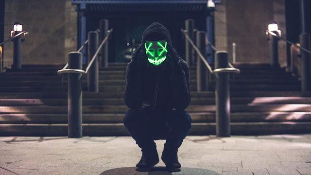 Hoodie Guy Green Neon Mask wallpaper+ Wallpapers Download